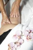 Beauty and Anti cellulite massage with orchids — Stock Photo