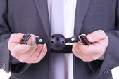 Businessman holding ball gag — Stock Photo