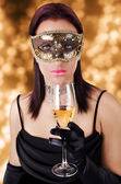 Beautiful woman in carnival mask — Stock Photo