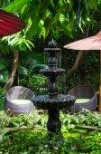 Stone fountain in the garden — Stock Photo