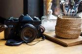 Old retro camera on vintage wooden table — Foto de Stock