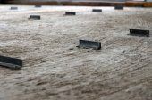 Steel angle on cement floor — Stock Photo