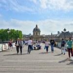Paris, France - May 13, 2015: People visit Institut de France and the Pont des Arts in Paris — Stock Photo #75169367