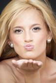 Portrait of Beautiful Blonde Woman  giving an air kiss — Stockfoto