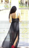 Beautiful woman from behind in a park  — Stockfoto