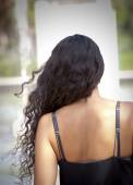 Beautiful woman from behind in a park  — Zdjęcie stockowe