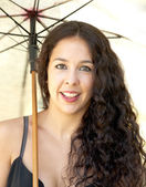 Beautiful woman in a park with umbrella  — Stock fotografie