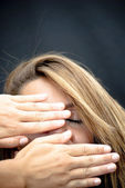 Beautiful  Woman with two hands covering her face — Stock Photo