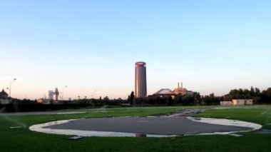 Panoramic view of the Pelli tower of Seville, from the heliport, with sprinklers running in Seville, Spain — Stock Video