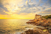 Boccale castle landmark on cliff rock and sea on warm sunset. Tu — Stock Photo