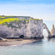 Etretat Aval cliff and rocks landmark and blue ocean . Normandy, — Stock Photo #57488807