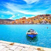 Wooden small boat in Porto Santo Stefano seafront. Argentario, T — Stock Photo