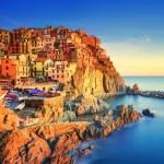 Manarola village, rocks and sea at sunset. Cinque Terre, Italy — Stock Photo #64347235