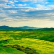 Tuscany, rural sunset landscape. Countryside farm, white road an — Stock Photo #67765987