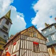 Old wooden facades and church in Honfleur Normandy, France. — Stock Photo #69485339