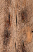 Old rusty nail on the old wooden background — Stock Photo