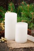 Christmas candle on the background of an old tree — Stock Photo