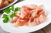 Hot fried bacon — Stock Photo