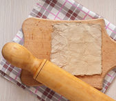 Old paper and wooden utensils for the kitchen, paper menu — Stock Photo