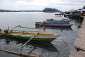 Traditional fishing boats at timber pier Indonesia — Stock Photo