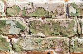 Old obsolete painted brick wall — Stock Photo