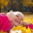 Child on leaves — Stock Photo #52425995