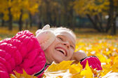Child on leaves — Stock Photo