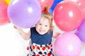 Baby girl and ballons — Stock Photo