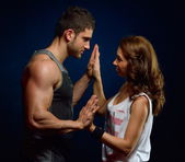 Young athletic couple  in the gym — Stock Photo