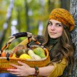 Young woman holding vegetables basket outdoor — Stock Photo #57246343