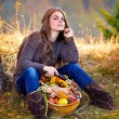 Young woman holding vegetables basket outdoor — Stock Photo #57246349