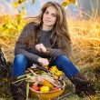 Young woman holding vegetables basket outdoor — Stock Photo #57246389