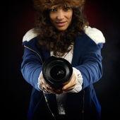 Young pretty woman holding photo lens — Стоковое фото