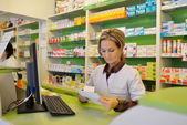 Female pharmacist holding prescription — Stock Photo