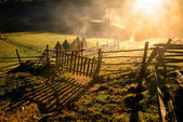 Mountain landscape with autumn morning fog at sunrise — Stock Photo