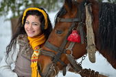 Beautiful brunette woman portrait with horse in winter — Stock Photo