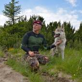 Man and his purebred Czechoslovakian wolf dog — Stock Photo