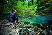 Caucasian woman tourist relaxing by the river, in the forest, Oc — Stock Photo