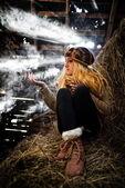 Beautiful woman relaxing in straw in autumn — Stock Photo