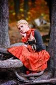 Beautiful elegant blonde woman in autumn forest — Stock Photo