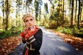 Beautiful elegant blonde woman in autumn forest — Foto de Stock