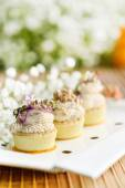 Assorted savoury holiday snacks on plate — Stock Photo