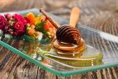 Golden honey on plate — Stock Photo