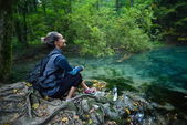Female tourist in the forest — Stock Photo