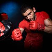 Personal trainer man coach and man exercising boxing in the gym — Stock Photo