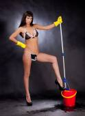 Girl in lingerie with a mop and bucket — Stock Photo