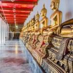 Aligned golden buddha statues Wat Pho temple bangkok Thailand — Stock Photo #57915257