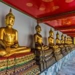 Aligned golden buddha statues Wat Pho temple bangkok Thailand — Stock Photo #57915785