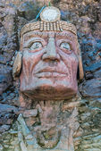 Inca face sculpture in the peruvian Andes — Stock Photo