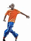 Hip hop acrobatic break dancer breakdancing young man silhouette — Stock Photo